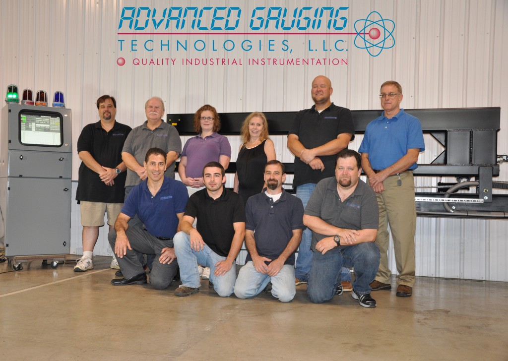 The AGT800 Laser Thickness Gauge Development Team Standing (from left to right): Todd Allen, Steve Venters, Sarah Hess, Coralie Cook, Craig Walkup and Jim Russell Kneeling (from left to right): Scott Cook, Rob Cook, Bob Cook and John Fearing Not pictured: Michael Bertin, Ph.D.